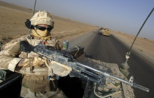 TA Soldier Riding Top Cover on Vector Vehicle
